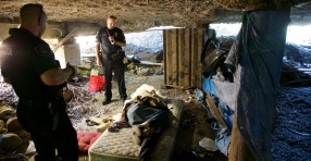 Oregon City Police Sgt. Matt Paschall checks on homeless camps in Oregon City, Oct. 9, 2014. The homeless are often hidden in suburbs but that doesn't mean they aren't there. Sgt. Paschall and another officer find a man sleeping under a ware house near the Clackamas River. Thomas Boyd/The Oregonian