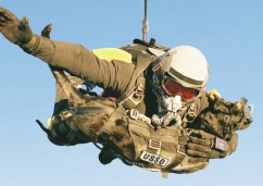Navy-seal-and-dog-parachuting-from-Helicopter