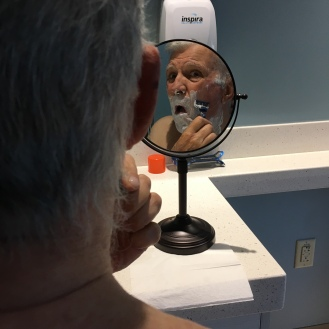 Shaving a face he doesn't recognize
